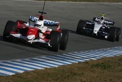 Timo Glock, Toyota F1 Team, TF107 and Nico Hulkenberg, WilliamsF1 Team, FW29-B