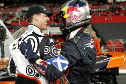 Michael Schumacher and Sebastian Vettel embrace as they win the Nations Cup for Germany