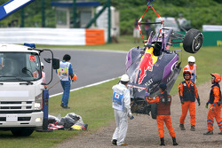 The Red Bull Racing RB11 of Daniil Kvyat is removed by marshalls after he crashed in qualifying