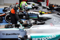 Sergio Perez, Sahara Force India F1 congratulates pole sitter Nico Rosberg, Mercedes AMG F1 W06 in parc ferme
