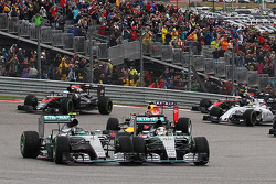(L to R): Nico Rosberg, Mercedes AMG F1 W06 and team mate Lewis Hamilton, Mercedes AMG F1 W06 battle for position at the start of the race