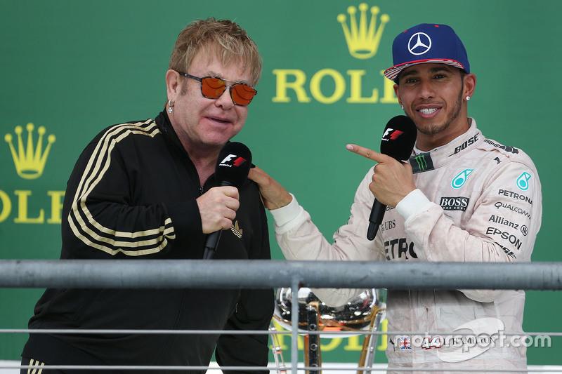 Race winner and World Champion Lewis Hamilton, Mercedes AMG F1 W06 with Elton John