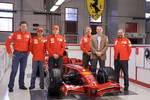 Kimi Raikkonen, Felipe Massa, Stefano Domenicali and team members pose with the new Ferrari F2008