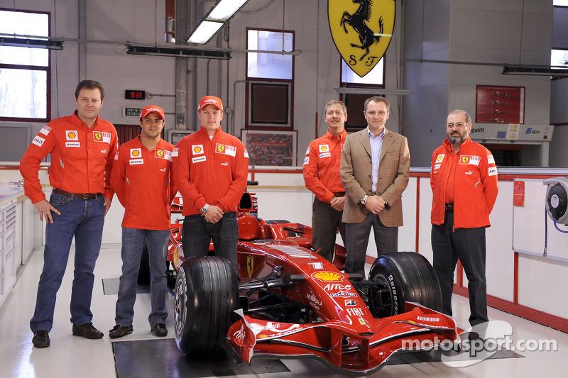 Kimi Raikkonen, Felipe Massa, Stefano Domenicali and team members pose with the new Ferrari F2008