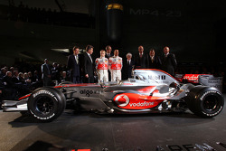 Lewis Hamilton, Heikki Kovalainen, Ron Dennis, Norbert Haug, Bernie Ecclestone and McLaren Mercedes team members pose with the new McLaren Mercedes MP4-23