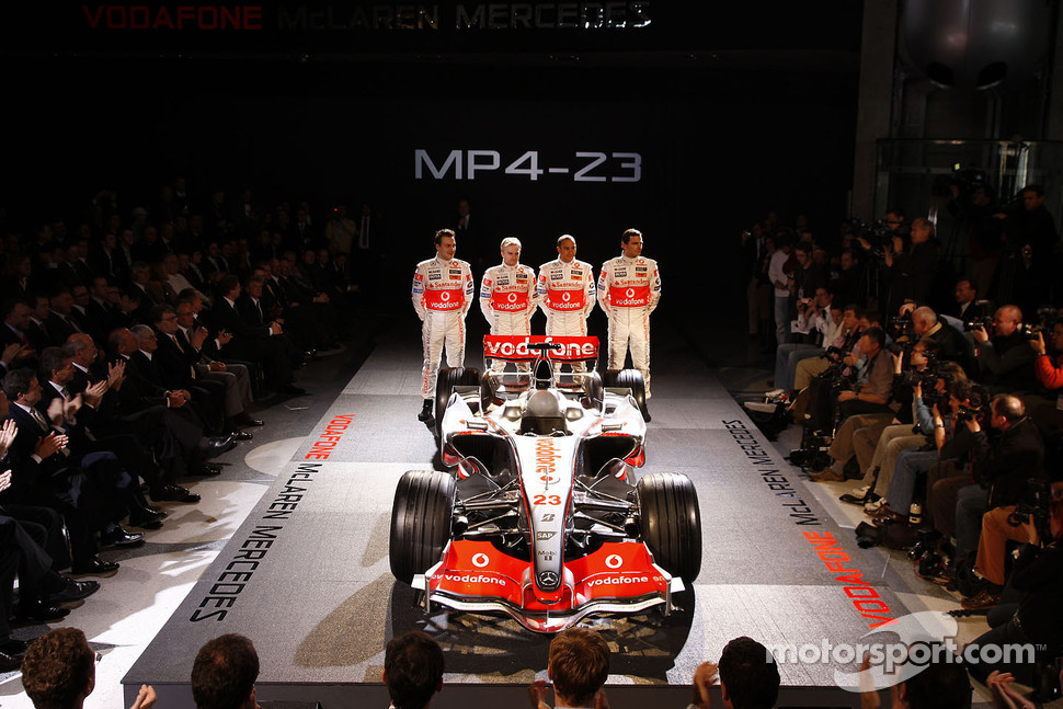 Gary Paffett, Heikki Kovalainen, Lewis Hamilton and Pedro de la Rosa pose with the new McLaren Mercedes MP4-23