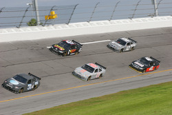 Jeff Burton leads a group of cars