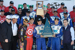 Victory lane: race winners Dario Franchitti, Juan Pablo Montoya, Scott Pruett, Memo Rojas celebrate with team members