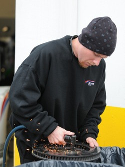 Mechanic Works on Parts