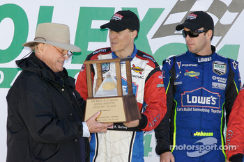 DP podium: Dan Gurney with son Alex Gurney and Jimmie Johnson