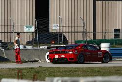 Jamie Melo contemplates his Ferrari's flat tire