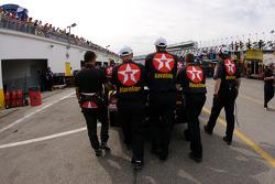Juan Pablo Montoya pushes his car to pit road