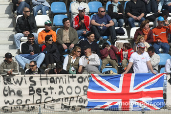 Fans in the grandstand with banners