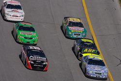 Steve Wallace and Brad Coleman lead a group of cars
