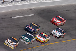 Dale Jarrett leads a group of cars in turn 4