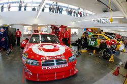 The cars of Reed sorenson and sitter Kyle Busch in the garage