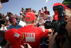 Kimi Raikkonen, Scuderia Ferrari signing autographs to the fans