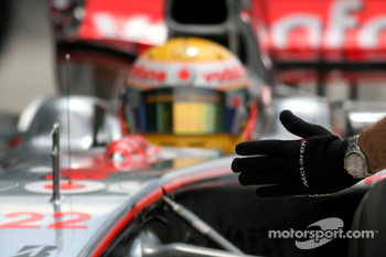 McLaren Mercedes, mechanics glove with Lewis Hamilton, McLaren Mercedes in the background