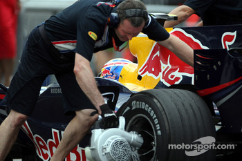 A crew member cooling the brakes of Mark Webber, Red Bull Racing