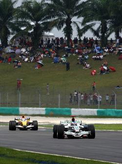 Jenson Button, Honda Racing F1 Team leads Nelson A. Piquet, Renault F1 Team