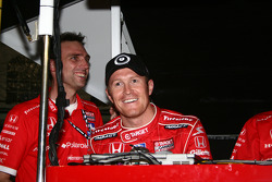Scott Dixon smiles after taking the pole