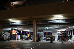 The Red Bull Team cars and mechanics at night