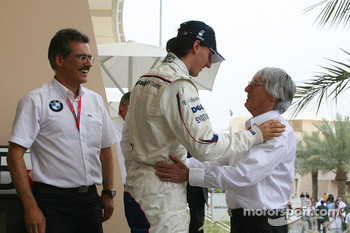Pole winner Robert Kubica is congratulated by Bernie Ecclestone