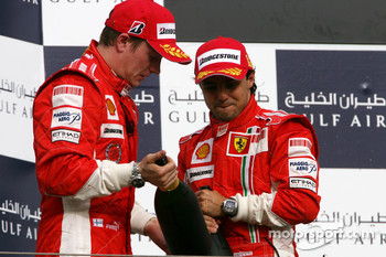 Podium: champagne for Felipe Massa and Kimi Raikkonen