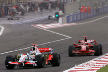 Adrian Sutil, Force India F1 Team, Kimi Raikkonen, Scuderia Ferrari