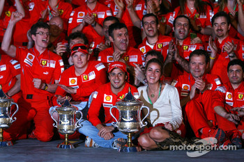Race winner Felipe Massa celebrates with his wife Rafaela, teammate Kimi Raikkonen,  Stefano Domenicali and Scuderia Ferrari team members