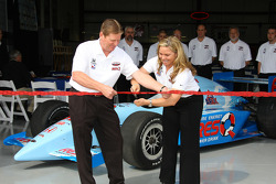 John O'Gara and Sarah Fisher cut the ribbon to officially open Sarah Fisher Racing's shop in Indianapolis