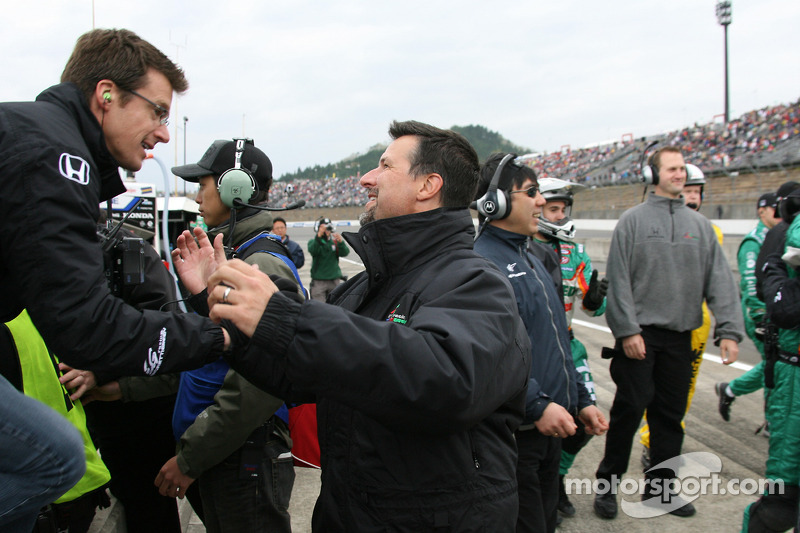 Danica Patrick's husband Paul and Michael Andretti celebrate as Danica Patrick wins the Indy Japan 300
