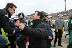 Danica Patrick's husband Paul and Michael Andretti celebrate as Danica Patrick wins the Indy Japan 300