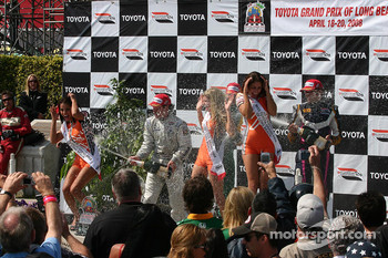 Podium: champagne for Will Power, Franck Montagny and Mario Dominguez