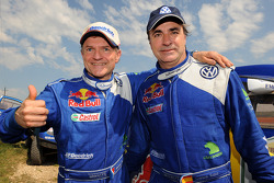 Rally winners Carlos Sainz and Michel Périn celebrate