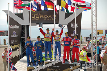 Podium: rally winners Mikko Hirvonen and Jarmo Lehtinen, second place Daniel Sordo and Marc Marti, third place Chris Atkinson and Stéphane Prévot