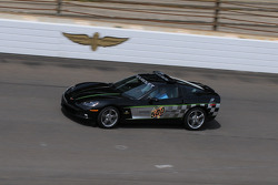 Johnny Rutherford driving the pace car Corvette before practice