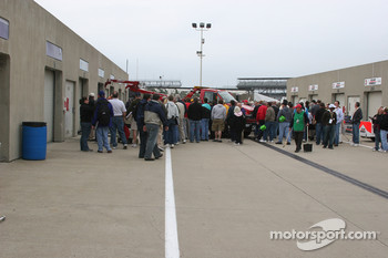 Crowds gather around Alex Lloyd's garage