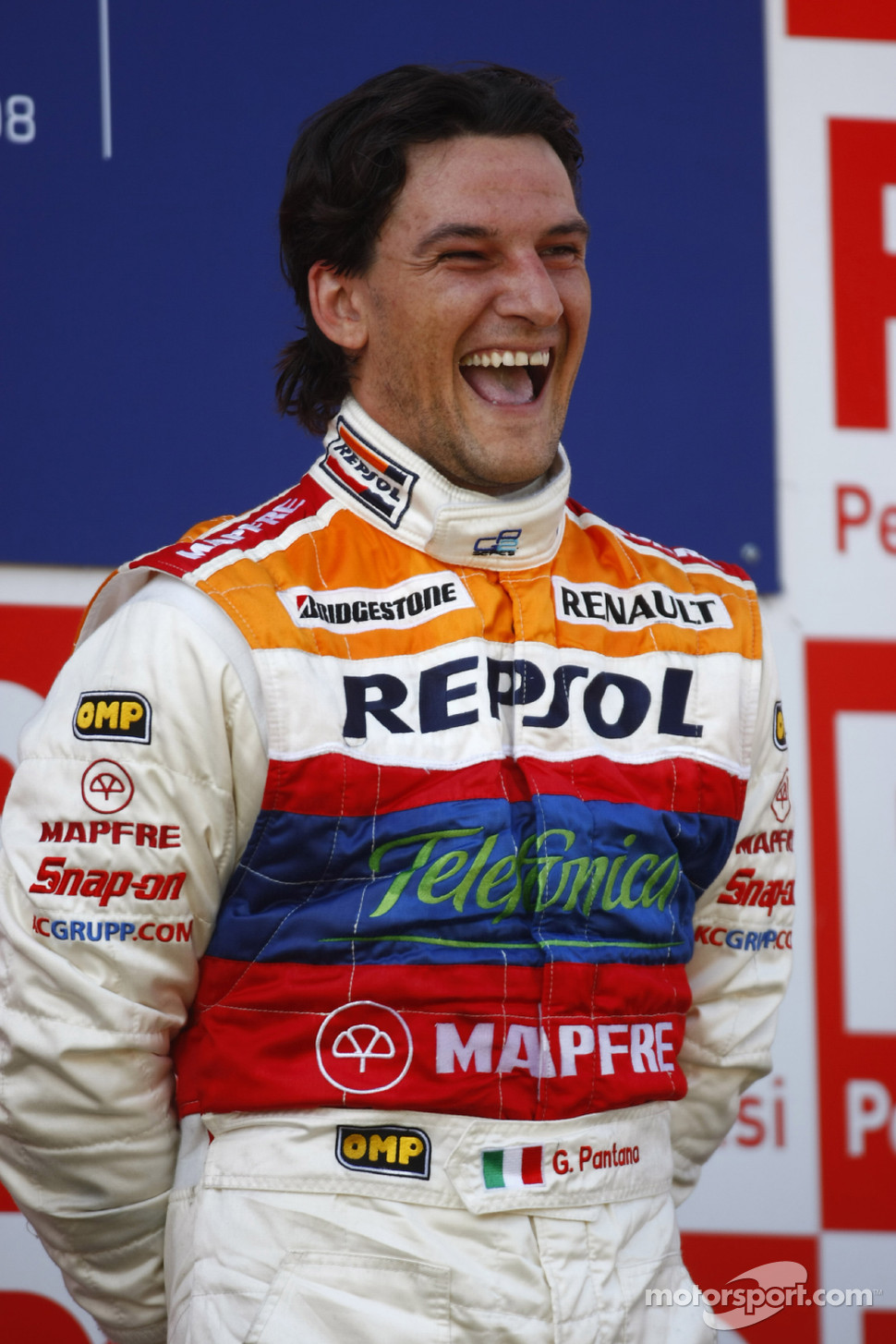 Giorgio Pantano celebrates victory on the podium