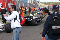 Spectators running on the track during the slow down lap