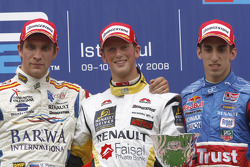 Romain Grosjean celebrates victory on the podium with Vitaly Petrov and Sebastien Buemi