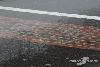 The famous yard of bricks beneath a puddle of rain on day two of qualifications