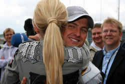 Cora Schumacher, wife of Ralf Schumacher, gives her husband a hug just before the start of the race