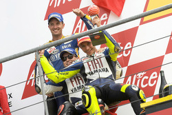 Podium: race winner Valentino Rossi celebrates with Jorge Lorenzo and Colin Edwards