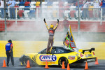 Burnout contest: Kyle Busch participates in the burnout contest