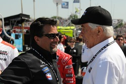 Michael Andretti talking with Roger Penske