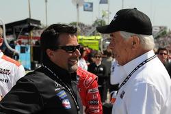 Michael Andretti talking with Roger Penske