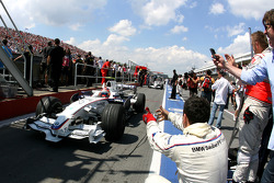 Race winner Robert Kubica celebrates