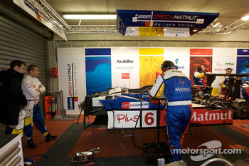 Team Oreca Matmut team members at work on the #6 car as Olivier Panis looks on