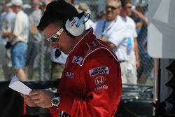 One of Ryan Briscoe's crew members checking a list